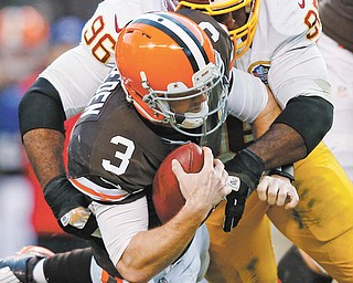 Redskins nose tackle Barry Cofield sacks Browns quarterback Brandon Weeden late in Sunday's game in Cleveland. The 38-21 loss to Washington ended Cleveland's slim playoff hopes, raised more questions about the rookie quarterback and likely triggered a massive overhaul in the weeks ahead.