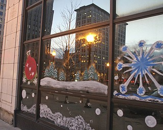William d LEwis The Vindicator   Holiday decorations on windows of downtown buildings.
