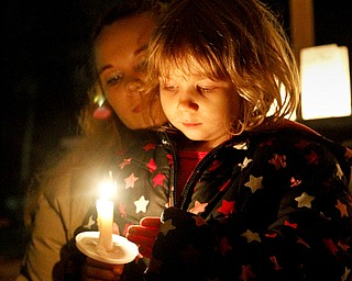 MADELYN P. HASTINGS | THE VINDICATOR..A candle light vigil took place in Lordstown to remember victims of the Newtown, Connecticut school shooting. (L-R) Cara Kowalczyk and Michelle Peterson, 4, of Lordstown reflect on the victims.... - -30-..