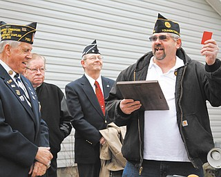 James Campbell, left, representative of the American Legion Department of Ohio, shares a laugh with Robert Raver, far right, commander of American Legion Post 472 in Youngstown, after Campbell presented the keys to Raver for the post's new $300,000 facility at 472 E. Indianola Ave.