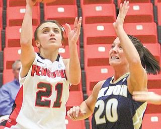 Youngstown State guard Liz Hornberger shoots past Akron's Taylor Ruper during Thursday's game at Beeghly Center. Hornberger scored seven points and the Penguins won 80-71.