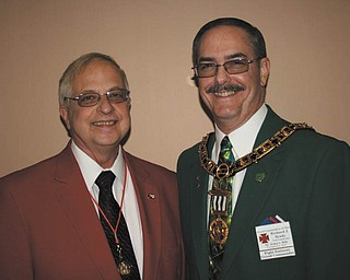 At the recent annual conventions of their respective bodies, James A. Streeky, left, was installed as the district education officer of the 19th District of the Grand Chapter of Royal Arch Masons of Ohio. A past officer of the local chapter, he will assist chapters in northeast Ohio in various programs. Richard J. Brady, who has served as a local and district officer, now assumes the leadership of more than 9,500 members of the Grand Commandery Knights Templar of Ohio. Photo: SPECIAL TO THE VINDICATOR