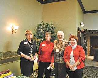 Niles Chapter of the American Sewing Guild officers are shown at a recent holiday party at Ciminero's Banquet Center, Niles. Barbara Rosier-Tryon, left, president; Marion Gibson, first vice president; Lynn Price, treasurer; and Diane Wittik, second vice president. Gretchen Saunders, secretary, was absent.
