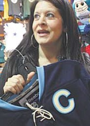 Stephanie Mansour, owner of Touchdown Gifts in Southern Park Mall, has a 95 percent hearing loss.