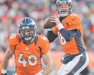 Denver Broncos quarterback Peyton Manning drops back to pass behind the blocking by running back Jacob Hester during Sunday's game against Cleveland. In a season besmirked by tragedies and scandals, 2012 also will be known as The Year of the Comeback in the NFL, with some of the game's greats — including Manning — not only regaining their old form, but somehow surpassing it.
