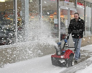William D LEwis The vindicator Jared Pekar, sales mgr of Do Cut in Boardman uses a  snow blower in front of his store.  By 1:30pm Wed he said the store sold 40 snow blowers.
