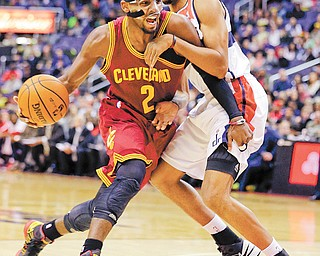 Cleveland Cavaliers guard Kyrie Irving (2) drives to the net against Washington Wizards guard Garrett Temple during the first half of Wednesday's NBA game in Washington. The Cavaliers downed the Wizards, 87-84, with Irving posting a game-high 26 points.