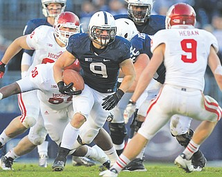 Penn State running back Michael Zordich (9) doesn't need to spend New Year's Day in Pasadena to prove his  final season came up roses. The Cardinal Mooney High graduate helped the Nittany Lions go 8-4 this season, including 6-2 in the Big Ten.