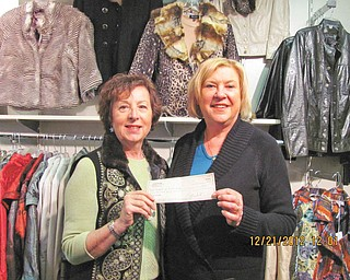 Jeannine Hodge, left, Angels of Easter Seals Holiday Brunch chairwoman, is shown receiving a $250 check from Linda Deckant, owner of Possessions, a women's boutique in Boardman, who shared proceeds from accessories sold at the brunch.