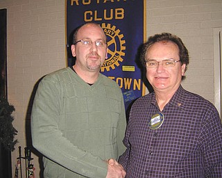 """PMG Chocolatier and Executive Vice President Ed Ridenbaugh was the speaker at a recent meeting of Austintown Rotary. Shown from left are Ridenbaugh with Ron Carroll, president of Austintown Rotary. Ridenbaugh said, """"To PMG, chocolate is an art."""" PMG has been in the candy business for more than 30 years and has developed its own product line, but also has the original Gorants recipe. Visit www.pmgchocolatier.com."""