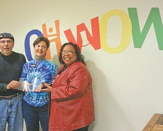 Suzanne Barbati, center, OH WOW! executive director, is shown with Ronald Faniro and Madonna Chism Pinkard, who received OH WOW! service awards as outgoing members of the board.