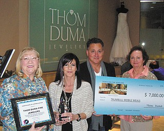 Trumbull Mobile Meals Inc. was the beneficiary of the generosity of Jacki and Thom Duma, center, of Thom Duma Fine Jewelers at their annual Basket Extravaganza. The jewelers donated a $6,000 diamond and a cubic zirconia for each of the 100 baskets in the silent auction. The winner of the silent auction basket redeemed the zirconia for the diamond at the end of the evening. Also shown are Sandee Mathews, left, chief executive officer of Trumbull Mobile Meals, and Kathy Keeler, mobile meals office manager.