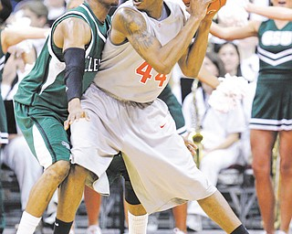 Cleveland State's D'Aundray Brown guards Ohio State's William Buford during a game in Columbus. His defense is what got Brown, an Ursuline grad, into the NBA's D-League with the Canton Charge.