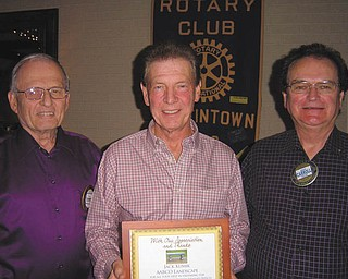 The Rotary Club of Austintown presented landscaper Jack Kumik of AABCO Landscape, center, with a plaque in appreciation for his help preparing the foundation for the Rotary memory bench placed at the Celebration Grove at Austintown Township Park. Also shown are Tony Cebriak, left, chairman of the park project, and Ron Carroll, Rotary president. Kumik aided the club in establishing the grove and continues helping with maintenance at the park.