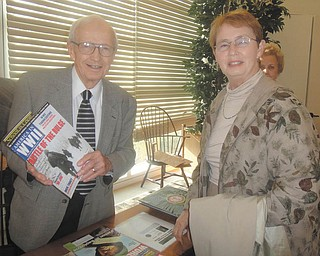 """Howard Friend discussed World War II literature with Sue Hawkins Bell. The Poland resident and educator shared details of his military service at the December meeting of the Austintown Friends of the Library. The presentation """"War is the Rage of Hell"""" outlined Friend's experience as an infantry machine-gun runner during the Battle of the Bulge. Bell will discuss """"A Journey from Somerset, England to Ohio"""" at the next meeting, 10 a.m. Jan. 28 at Austintown Library, 600 S. Raccoon Road."""