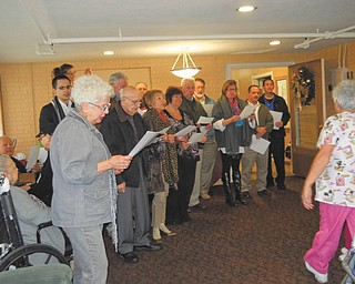Struthers Rotary members visited Maplecrest Nursing Home, 400 Sexton St., Struthers, recently and entertained residents with Christmas carols. They were led by Rotarian Mary Ann Morell.