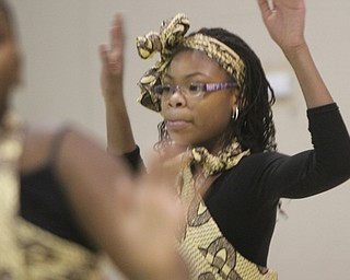 William D Leiws the Vindicator  Jade Frazier, 12, member of Harambee dancers performs plays during Kwanzaa celebration Tuesday at McGuffey Centre.