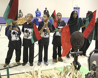 William D Lewis the Vindicator Youth hold African flags  during Kwanzaa celebration Tuesday at McGuffey Centre.