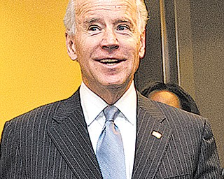 Vice President Joe Biden arrives for a closed-door meeting with House Democrats, on Capitol Hill in Washington on Tuesday to discuss the fiscal cliff bill. Biden had been shuttling between the White House and Capitol Hill to help with negotiations.