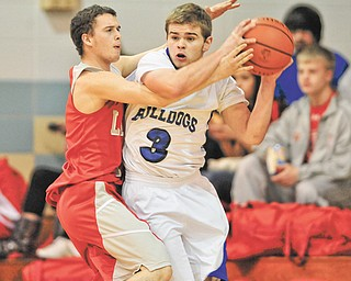 Lakeview's Justin Journey (3) tries to pass the ball under pressure by LaBrae's Chris Clevenger (1) during their All-American Conference basketball game Wednesday at Lakeview High School in Cortland. The Vikings dominated the Bulldogs, 77-19.