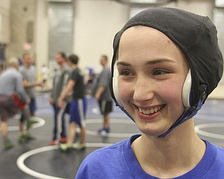 William D Lewis the Vindicator Hubbard sophomore wrestler Shirley Flynn warms up before a recent practice.  She is one of just a few girl wrestlers in the state.