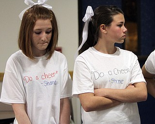 William D. Lewis the Vindicator  Wilmingotn HS cheerleaders Jenna Gates, left, and Alyssa Davis wear shirts remembering classmate who was killed in traffic accident.