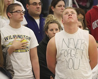 William D. Lewis the Vindicator  Somber faced students at Wilmingotn HS wear white in honor of classmate killed in traffic accident.