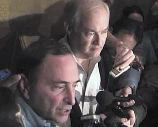 In this image from video, NHL commissioner Gary Bettman, left, talks to the media as Donald Fehr, executive director of the NHL Players' Association, stands next to him, in New York, early Sunday.