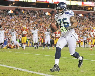 Seattle Seahawks fullback Michael Robinson crosses the goal line for a touchdown during the first half of their NFC wild card playoff game against the Washington Redskins in Landover, Md., on Sunday. The Seahawks won, 24-14.