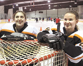 The Canfield High hockey team includes two female players — goaltender Megan Cole, left, and forward Brittany Bettile. Both are juniors.