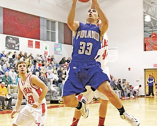 Poland's George Chammas (33) goes to the hoop against LaBrae during their game on Tuesday in Leavittsburg.