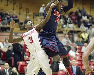 William D Lewis the Vindicator  Detroits Doug Anderson (23) pulls down a rebound past YSU's Kendrick Perry(3) during 1rst half action Thursday 1-9-13 at YSU.