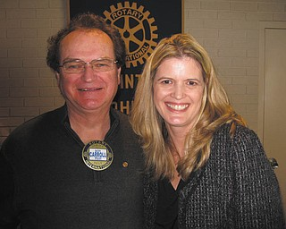 Shown are Ron Carroll, left, Austintown Rotary president, and Michele Merkel, Junior Achievement speaker. Austintown School Superintendent Vince Colaluca introduced Merkel at a recent meeting of the Rotary Club of Austintown. Merkel said JA invests in education, serving more than 600 classrooms in the area. Austintown Middle School, led by teacher Michelle Porter, is planning a JA Day on May 10. They need 30 volunteers and financial contributions to help them teach six lessons about the economy and world trade. Photo is Special to The Vindicator.