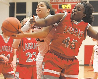 Bree Bishop (32) of Girard goes to the hoop against LaBrae's Ashlee Stubbs (45) during their basketball game Thursday in Girard. The Indians downed the Vikings, 52-34, with Bishop scoring a game-high 16 points and grabbing 16 of the team's 31 rebounds.
