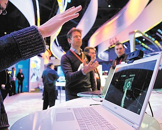 Convention attendees tried out Intel's Creative Interactive Gesture Camera development kit at the Consumer Electronics Show on Friday in Las Vegas.