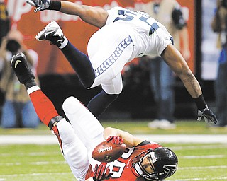 Atlanta Falcons tight end Tony Gonzalez (88) catches a pass under Seattle Seahawks middle linebacker Bobby Wagner (54) in the second half of Sunday's NFC divisional playoff game in Atlanta. The Falcons slipped by the Seahawks, 30-28, on a 49-yard field goal by Matt Bryant with 8 seconds to play.