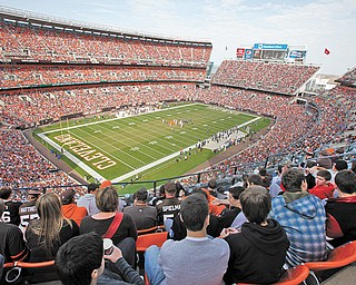 Fans watch the action in Cleveland Browns Stadium during a game between the Cleveland Browns and the Seattle Seahawks on Oct. 23, 2011.