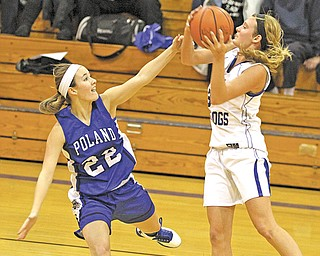 Lakeview's Abby Pavlik (3) looks to pass as Poland's Marissa Trevis (22) defends during the first half of a game Monday night. Lakeview used full-court pressure to pull away from a first-quarter tie for a 45-29 victory.