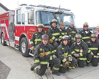Western Reserve Fire District personnel pose with the department's new $414,000 fire engine. The Saber model engine from Pierce Manufacturing was ordered in April and arrived Dec. 29. It replaced a 1983 engine that was worn down and did not meet current safety standards. Firefighters have transferred equipment to the new truck and undergone training on how to use it.