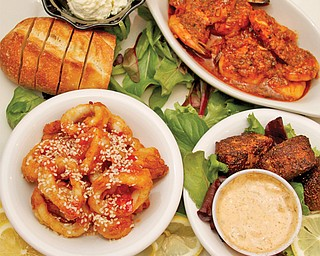 Sample of several small seafood appetizers at Steamers Tavern