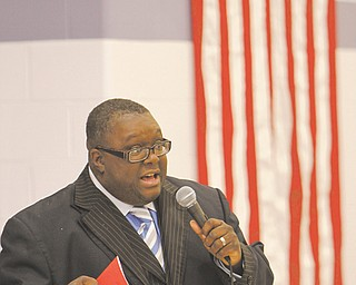 The Rev. Lewis Macklin talks about civil-rights leaders Dr. Martin Luther King Jr. and Rosa Parks and the second inauguration of President of Barack Obama during a Martin Luther King Jr. program Wednesday at Williamson Elementary School in Youngstown.