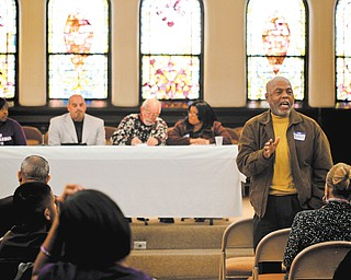 The Rev. Lawrence C. Underwood of Youngstown speaks to participants at the 30th annual Rev. Dr. Martin Luther King Jr. Community Workshop, which was Monday at First Presbyterian Church in Youngstown.