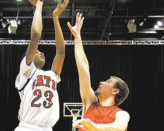 Struthers' Ray'Quan Phifer (23) shoots over Hickory's Marcus Sonoga during the first quarter of their game Tuesday at the Covelli Centre. Hickory won 60-33.
