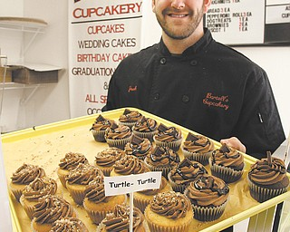 """Josh Bartell opened Bartell's Cupcakery in Struthers in February 2011, appeared on the reality competition TV show """"Cupcake Wars"""" and moved the bakery to 82 N. Main St. in Poland as 2012 came to a close. Now, with the help of other local businesses, Bartell is planning to give back in a big way with a free wedding."""