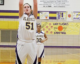 Champion's Mackenzie Kiser shoots her 1,000th career point on a free throw during the first period of a game Thursday against Campbell at Champion High School. The Golden Flashes routed the Red Devils, 61-22.