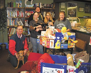 Shepherd of the Valley celebrates Operation Santa Paws Shepherd of the Valley Poland (SOV) collected cat and dog food, treats, beds, blankets, cleaning supplies and toys during the holiday season for Operation Santa Paws, a drive to benefit area animals. A donation for Alchemy Acres was received by Steve Sacco, left, holding Chanel; Katie Sacco with Palamino; Paula Blakeman, SOV Poland activity director and Santa Paws organizer, with Roxie; and Julie Sacco. In back is Donnie Fatou, a materials management clerk for SOV.