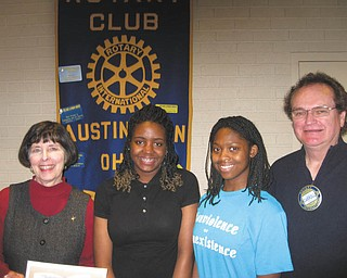 Rotary hosts students who attended Sojourn At a recent gathering of Austintown Rotary, Ron Carroll, president, welcomed guests, from left, Penny Wells, retired Youngstown teacher, and Michelle Morgan from East High School and Sarina Chatman from Chaney High School. Last year, they participated in Sojourn to the Past that takes students to visit Civil Rights sites in the South and students receive social studies credit. Rotarian Jerry Haber introduced the guests. Rotary will sponsor a fundraiser at 6:30 p.m. March 2 at the Maronite Center in Youngstown. The reverse raffle event will include dinner, dancing, basket auction and chance to win $2,000 in cash prizes. For tickets, contact any Rotary member or Deanna Spirko at 330-545-1550.