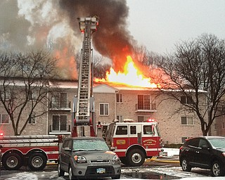 Fire crews from Boardman, Austintown and Canfield battle an apartment blaze that broke out about 8:30 a.m. Monday at 6849 Lockwood Blvd. in Boardman. A woman was taken to the hospital, where she later died.