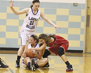 Fitch's Megan Sefcik, right, battles Lakeview's Abby Pavlik for control of the ball as Rebecca Mansell (20) watches Monday. Sefcik took control in the second half as Fitch won, 69-47.