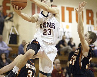 William d Lewis the vindicator Ridge's Nate Palmer(23) goes for 2 past Springfield's Jared McTigue(32).